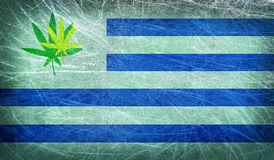 Grunge flag of Uruguay with a cannabis leaf Royalty Free Stock Image