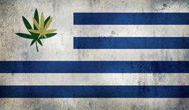 Grunge flag of Uruguay with a cannabis leaf Stock Images