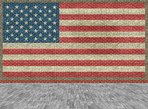 Grunge flag of the USA on a brick background with wooden floor Royalty Free Stock Photos