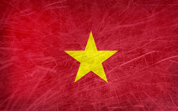 Grunge flag of Vietnam. A yellow star on red background Stock Images