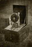 Grunge folding camera background. An antique folding camera on a grunge background Royalty Free Stock Photography