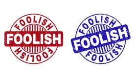Grunge FOOLISH Textured Round Stamp Seals. Grunge FOOLISH round stamp seals isolated on a white background. Round seals with grunge texture in red and blue royalty free illustration