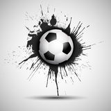 Grunge football or soccer ball background. Soccer or football on a grunge background Stock Photo