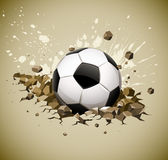 Grunge football soccer ball falling on ground Stock Image