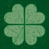 Grunge four leaf clover. Four leaf clover with grunge pattern on green background Royalty Free Stock Images