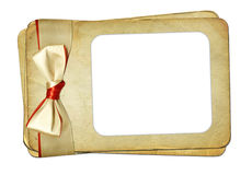 Grunge frame with bow on isolated background Royalty Free Stock Photo
