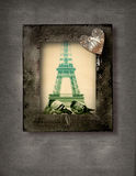 Grunge frame with doves and Eiffel Tower. Wooden grunge frame with two doves on the background of Eiffel Tower in Paris and a rustic heart Stock Photography