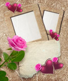 Grunge frame with roses, hearts and paper. Old grunge photo frame with roses, hearts and paper for letter Stock Images