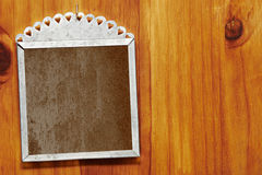 Grunge frame on wood. Royalty Free Stock Image