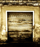 Grunge garage background with portcullis Royalty Free Stock Image