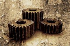 Grunge gears. Interlocking gears on textured grunge background Stock Photography