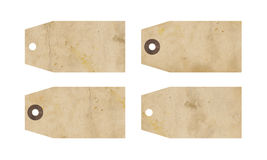 Grunge gift tags. A set of four grunge brown gift tags, isolated on white background Royalty Free Stock Photos
