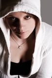 Grunge girl. Harsh shadows on a girl in a hoodie. Grunge theme Royalty Free Stock Image