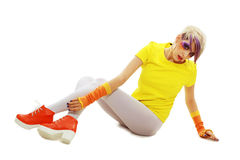 Grunge girl down floor. Fashion glamour grunge girl in yellow with creative paint make up sitting down the floor Stock Image