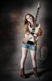 Grunge girl with guitar Stock Image