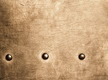 Grunge gold brown metal plate rivets screws background texture Stock Images