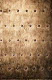 Grunge gold brown metal plate rivets screws background texture Stock Photos