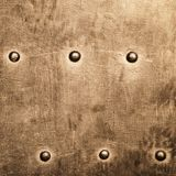 Grunge gold brown metal plate rivets screws background texture Stock Photography