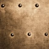 Grunge gold brown metal plate rivets screws background texture Stock Photo