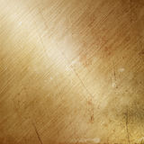 Grunge gold brushed metal Stock Photos