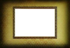 Grunge gold frame. Grunge frame on gold wallpaper Stock Photo