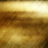 Grunge gold metal background with cracks and scratches Royalty Free Stock Photos