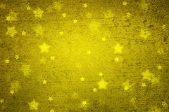 Grunge golden blurred star shapes Xmas background Royalty Free Stock Images
