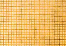 Grunge golden mosaic tiles texture. For background Royalty Free Stock Image