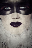 Grunge gothic masked beauty. Beautiful woman with gothic make-up covered in painted mask on grunge texture Royalty Free Stock Photos