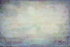 Grunge grainy blue paper with writing. Old grunge paper as background or overlay Royalty Free Stock Image