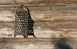 Grunge grater on log house wall. Royalty Free Stock Photos