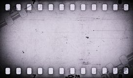 Grunge gray scratched dirty film strip background. stock illustration