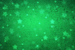 Grunge green blurred Xmas star shapes background. Grunge magical blurry star shape abstract Christmas and New Year Holidays copy space on green background Stock Photo
