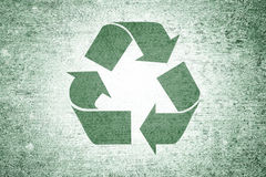 Grunge green conceptual large recycle symbol background Royalty Free Stock Photo