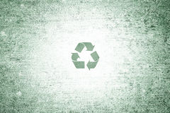 Grunge green conceptual small recycle symbol background Royalty Free Stock Photography