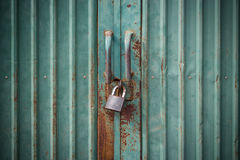 Grunge green door lock. With key Stock Photography