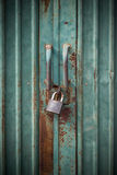Grunge green door lock. With key Royalty Free Stock Images