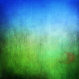 Grunge green field and blue sky Royalty Free Stock Photography