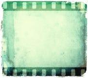 Grunge green film strip frame. Background Stock Images