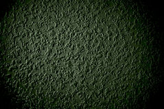 Grunge green grained wall background or texture. Closeup of grunge grained wall stock image