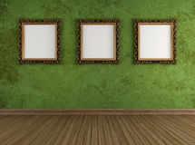 Grunge green room with golden frames Royalty Free Stock Photography