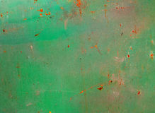Grunge green rusty metal. Grunge texture of green rusty metal with scratches Royalty Free Stock Images