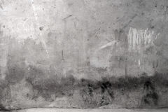 Grunge grey cement wall. Grey grunge cement wall with some scribbles royalty free stock photography