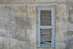 Grunge Grey Metal door on Old Concrete wall. Stock Image