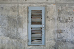 Grunge Grey Metal door on Old Concrete wall. Stock Photos
