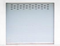 Grunge grey steel roller shutter door royalty free stock photos