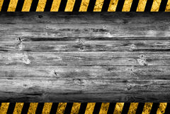 Grunge grey wood background with warning stripes. Grunge grey wood background with black and yellow warning stripes vector illustration