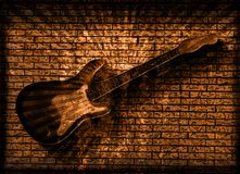 Grunge Guitar. Vintage Grunge Style Background With Guitar on Brick Wall Stock Photography