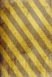 Grunge ha barrato la priorità bassa della bandiera del pericolo Fotografie Stock Libere da Diritti