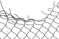 Grunge ha schiacciato la barriera di sicurezza arrugginita del collegare isolata Fotografia Stock